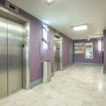 two elevators in hallway at District 3 Hotel, An Ascend Hotel Collection Member