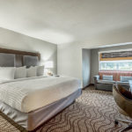 one king bed with sofa in room at District 3 Hotel, An Ascend Hotel Collection Member