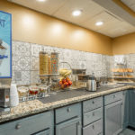 yogurt station, cereal dispensers, and pastries at District 3 Hotel, An Ascend Hotel Collection Member