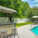 outdoor pool and bar stand area